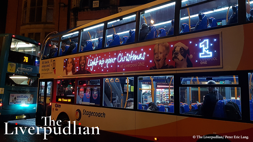 A bus celebrating shopping in Liverpool ONE during the festive Christmas season on the side of a Liverpool City Centre bus (Credit: The Liverpudlian/Peter Eric Lang).