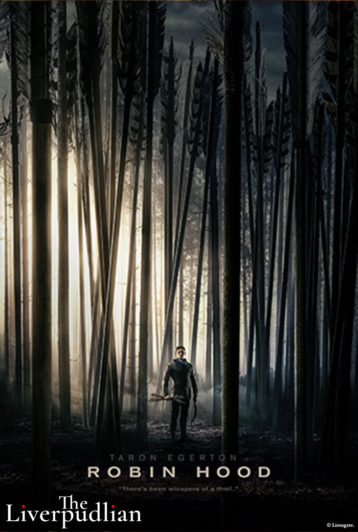 Taron Egerton as Robin Hood in a forest of arrows (Credit: Lionsgate).