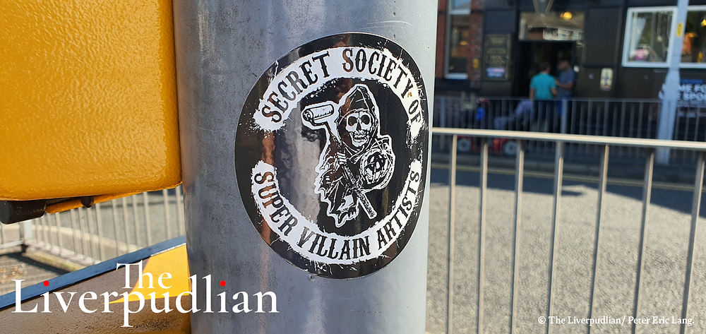A sticker of The SSOSVA at the junction outside of the Halfway House pub on Woodchurch Road in Prenton (Credit: The Liverpudlian/Peter Eric Lang).