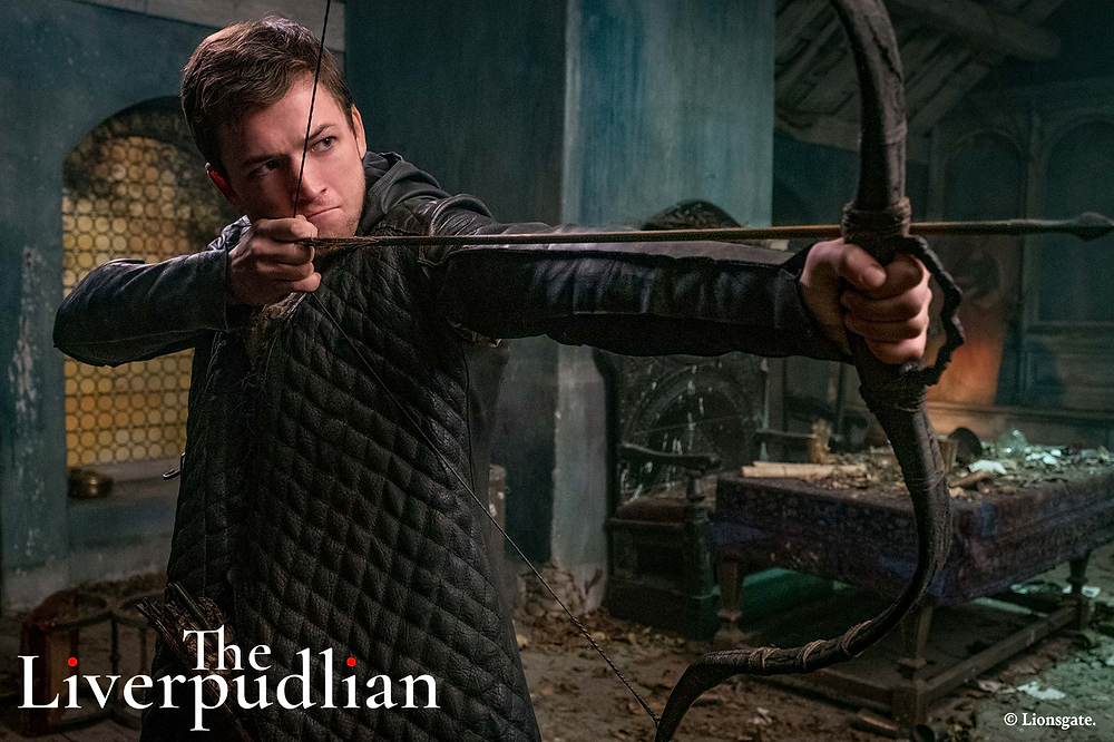 Taron Egerton starring in the 2018 blockbuster film, Robin Hood (Credit: Lionsgate).