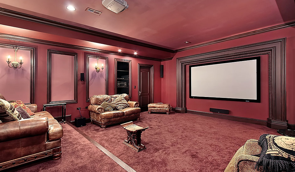 Theater room in luxury home with stadium seating