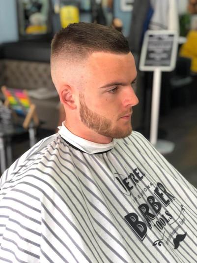 beard and men's haircut at mac's hair an