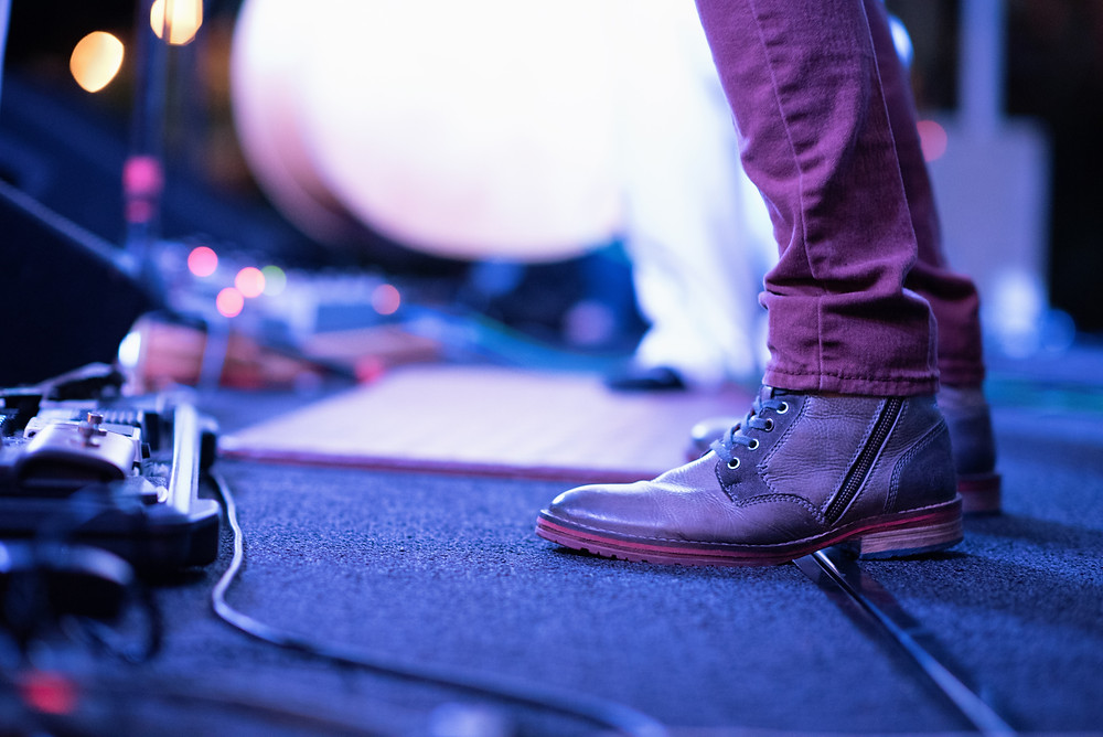 Photo of someone's booted feet standing on a stage.