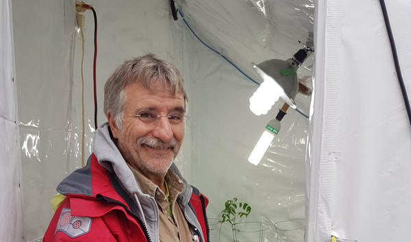 George Dashner of The Gaia Project conducting an energy assessment of the propagation room in our greenhouse. One of our goals for the greenhouse is to be completely off-grid, powered entirely through solar energy.
