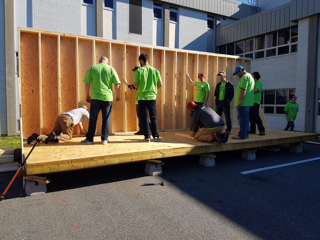 Volunteer NBCC students helped construct the greenhouse frame