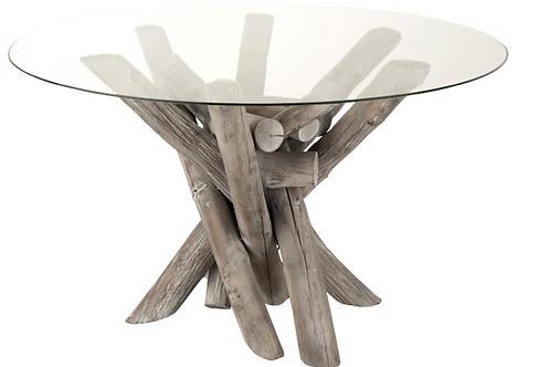 Mesa sala redonda com troncos de madeira e tampo vidro cinza