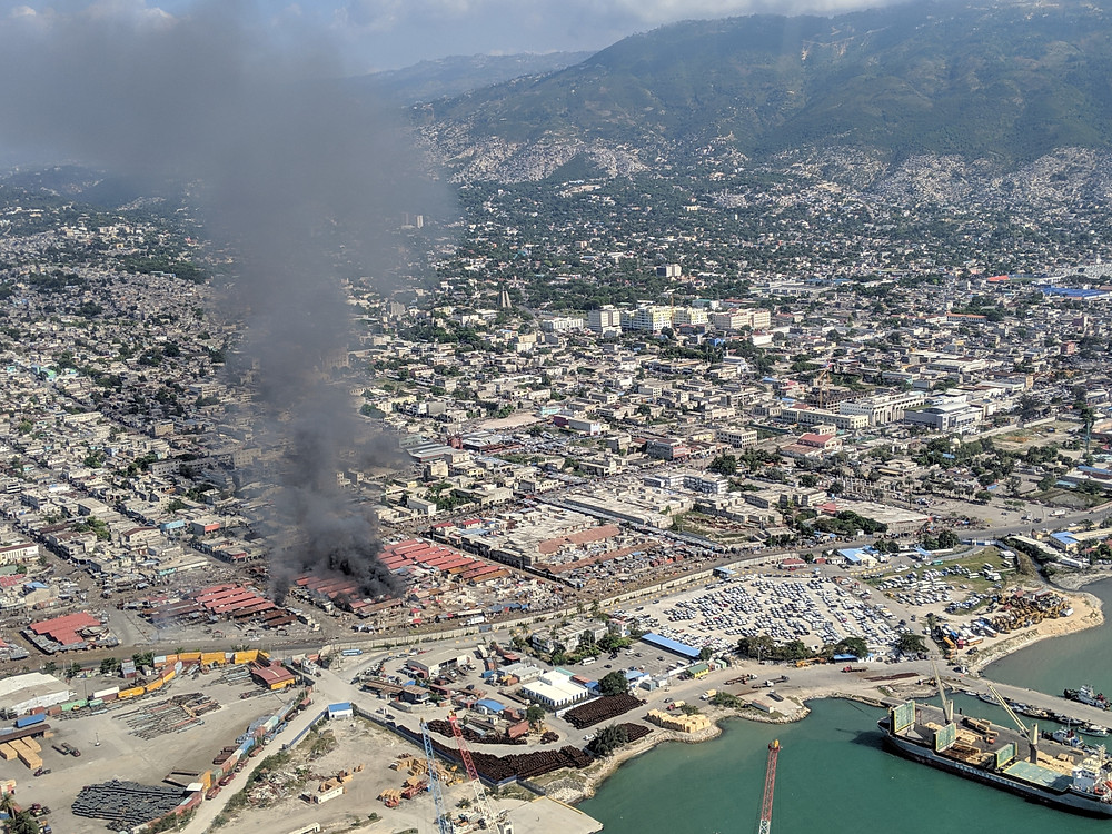 Fires from a burning market set on fire during a riot in Port au Prince in April, 2019