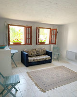 loire gite main bedroom with windows to swimming pool area