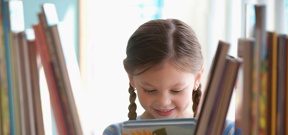 Smiling Girl with Book.jpg