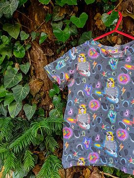 Organic cotton jersey t shirt featuring rock symbols and kurt cobain as a cow