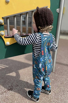 Organic jersey childrens dungarees featuring a Day at the Museum design