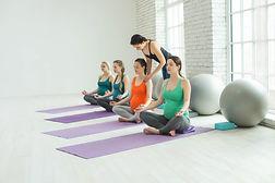 Group of pregnant woman doing yoga .jpg