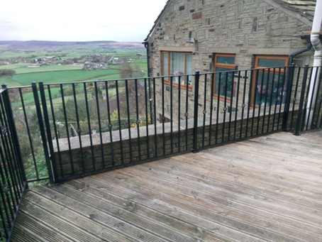 Day 1 of fitting a railing surrounding a decking area.