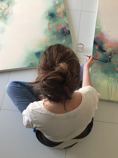 Melissa Goodenough Art in studio with paintings