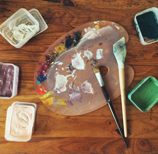mixing paint palette colour swatches in artist studio