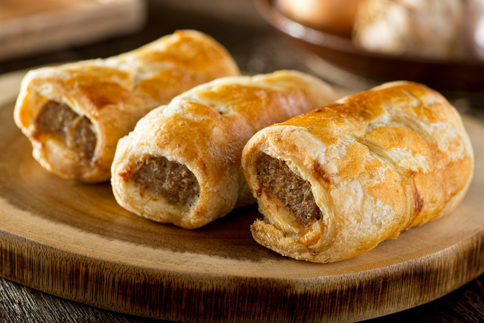 Delicious homemade sausage rolls on a wo