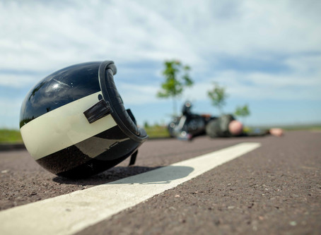 Who is at fault if my motorcycle accident was caused by a pothole?