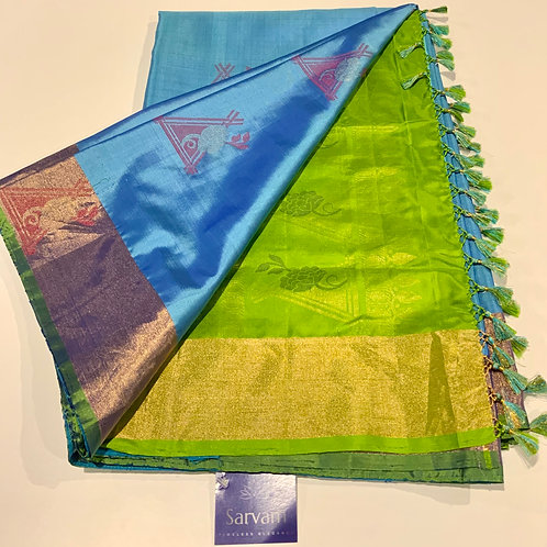 Sky Blue Kanchi with a Beautiful Parrot Green Pallu