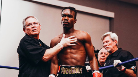HOLY POW Boxing legend Evander Holyfield's son Evan wins in 82 seconds to remain unbeaten with dad and brother Elijah ringside
