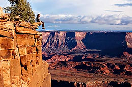 Picture of man sitting on cliff