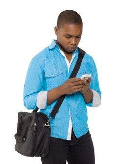 Kozzi-young_student_looking_to_his_phone-312x416.JPG