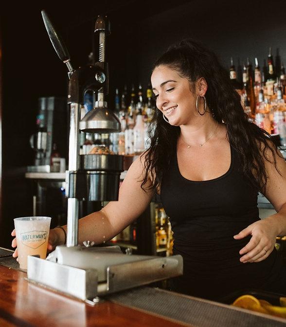 Photo of bartender making an orange crush