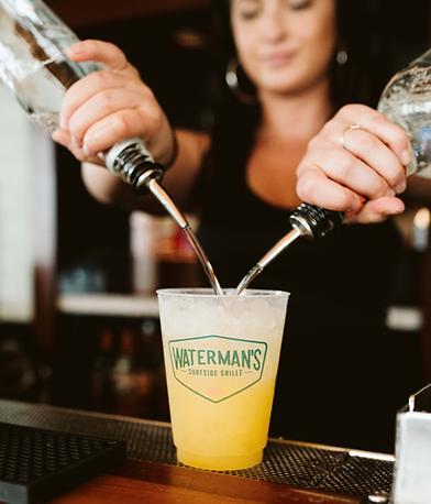 Waterman's Bartender making an orange crush