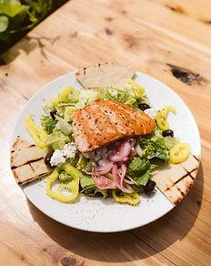 Waterman's lunch menu with photo of greek salmon salad