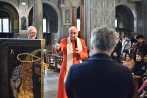 The art work being blessed by Cardinal Vincent Nichols