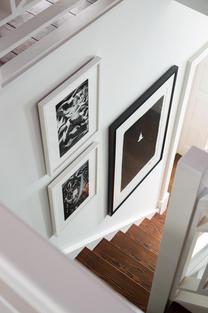 Various prints in stair well.