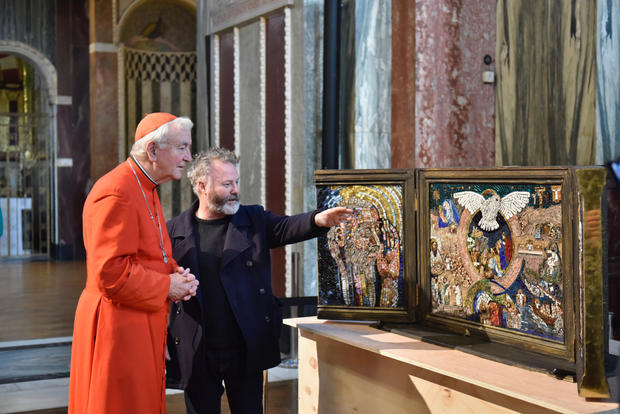 The artist Pete Codling with Cardinal Vincent Nichols at Westminister Cathedral discussing the work in progress.
