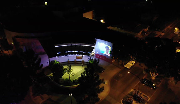 Drone footage of the Faces of... Exhibiton opening night display on the outside of the Emerald Gallery