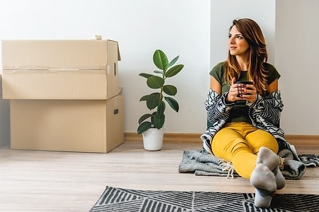 young-woman-enjoying-her-new-apartment-1