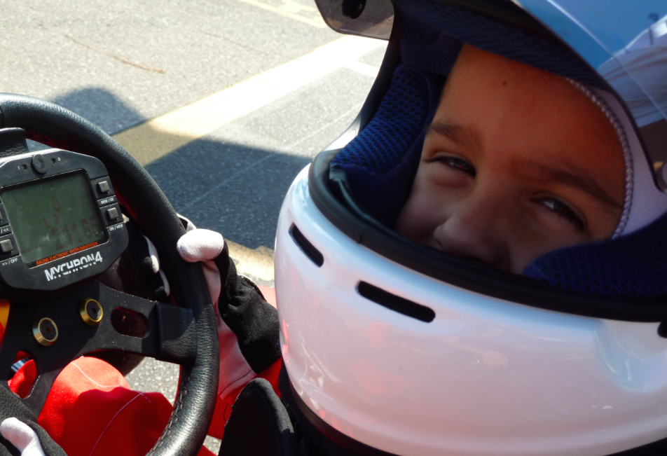With his new helmet at age 4.