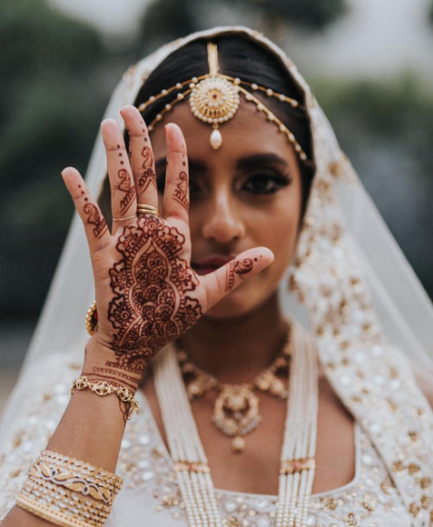 Indian bridal makeup. Indian bride getting ready.