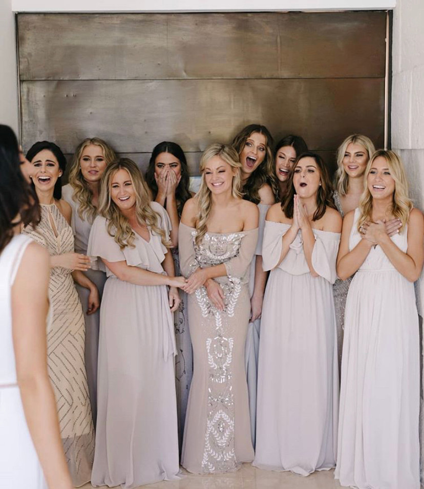 getting ready bride with bridesmaids
