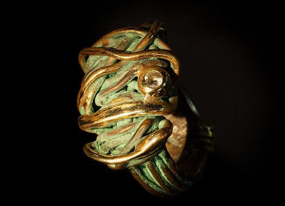 Anello in bronzo, oro e argento con diamante