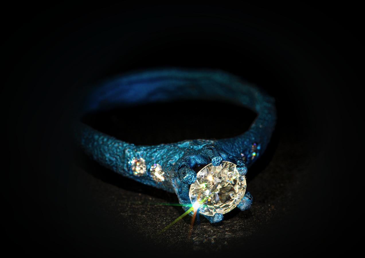 Solitario in titanio muto e diamanti