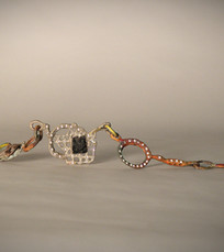 Collana scoria, oro e diamanti