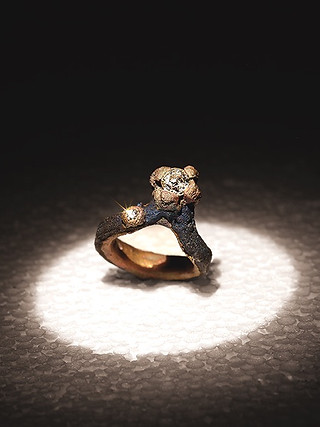 Anello solitario in ferro-oro e diamante