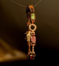 Bracciale in bronzo, oro, argento e inclusioni