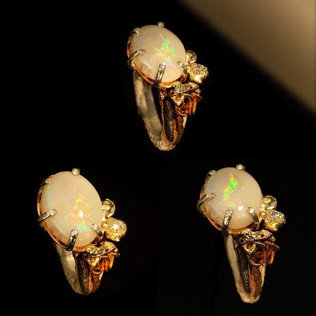 anello in argento, ferro, bronzo, oro e opale