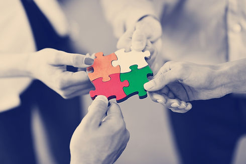 group-of-business-people-assembling-jigs
