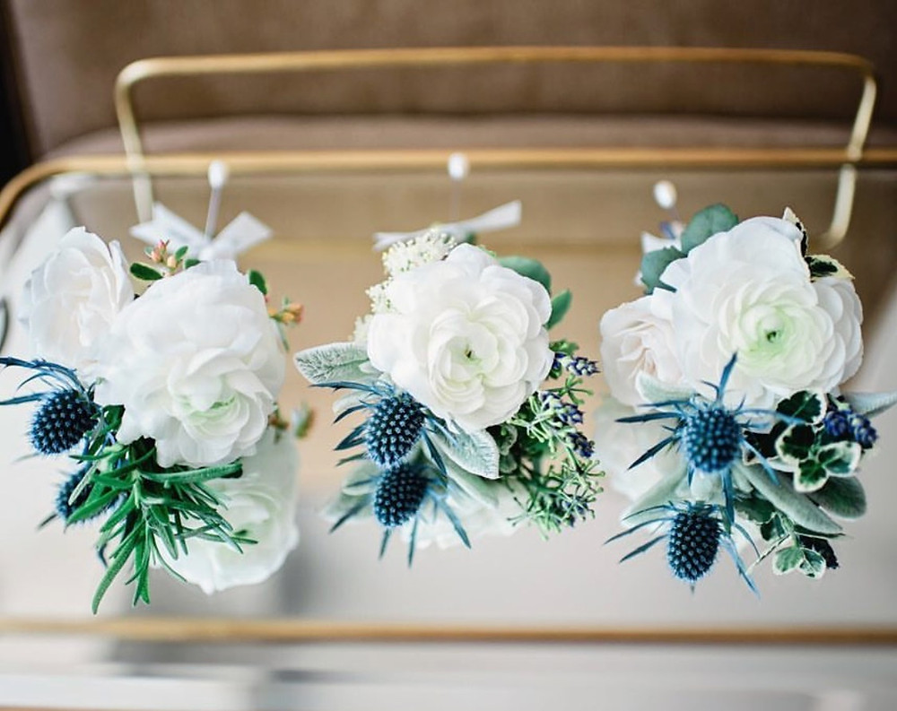 A slightly different designs with white Ranunculus, dusty blue Thistles, Lavenders, Lam's ears, white Spray roses, and various greens