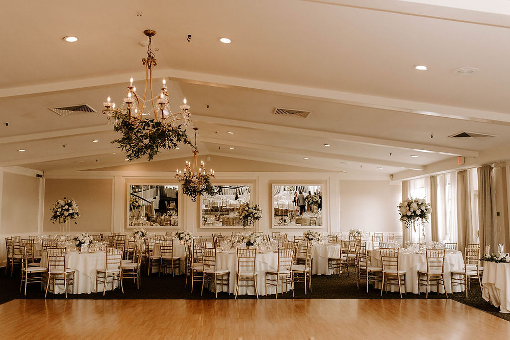 Natural and elegant style white centerpieces at The Inn at Longshore