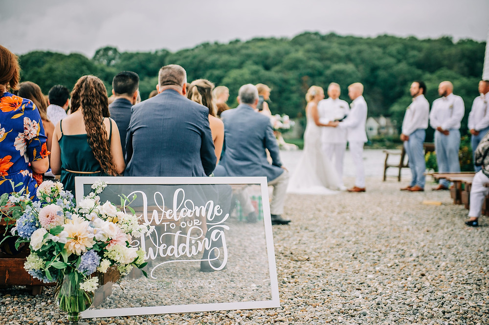 Pastel summer dahlia wedding ceremony at Boat shed in Mystic Seaport Museum