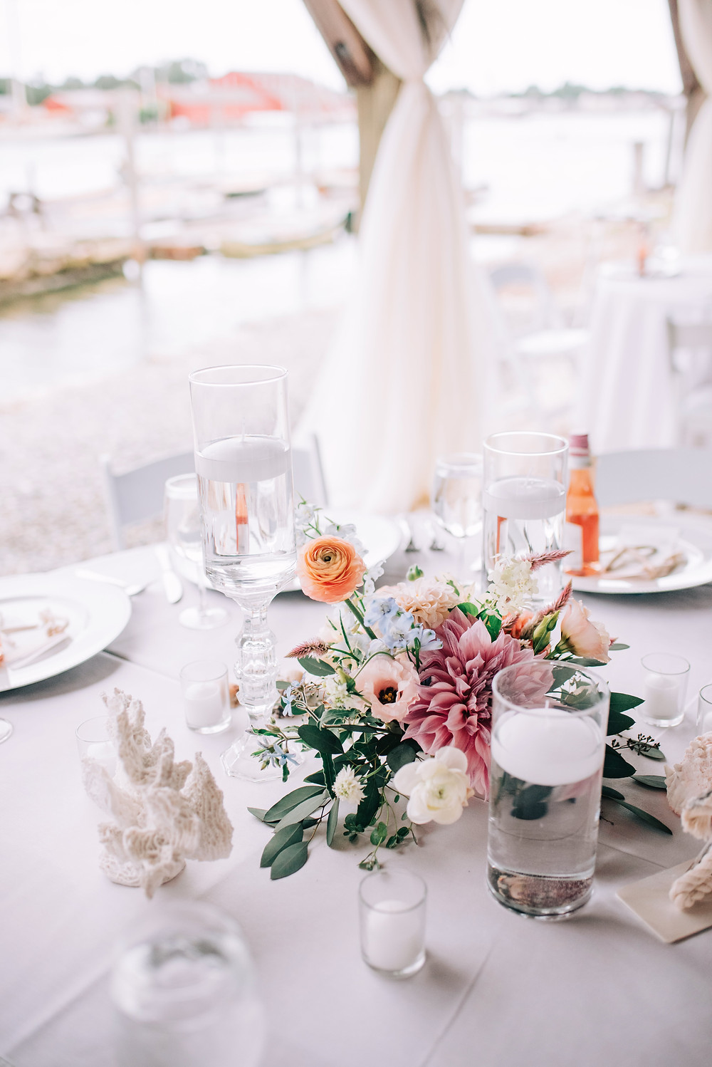 Blush & light blue Dahlia centerpieces with floating candles at Boat shed in Mystic Seaport Museum