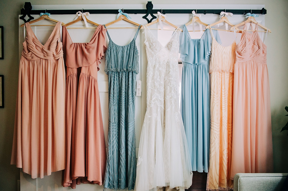 Pastel various colored bridesmaid's dresses