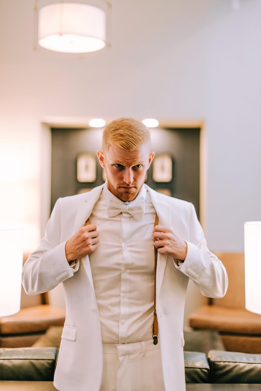 Groom getting ready in Mystic Hotel