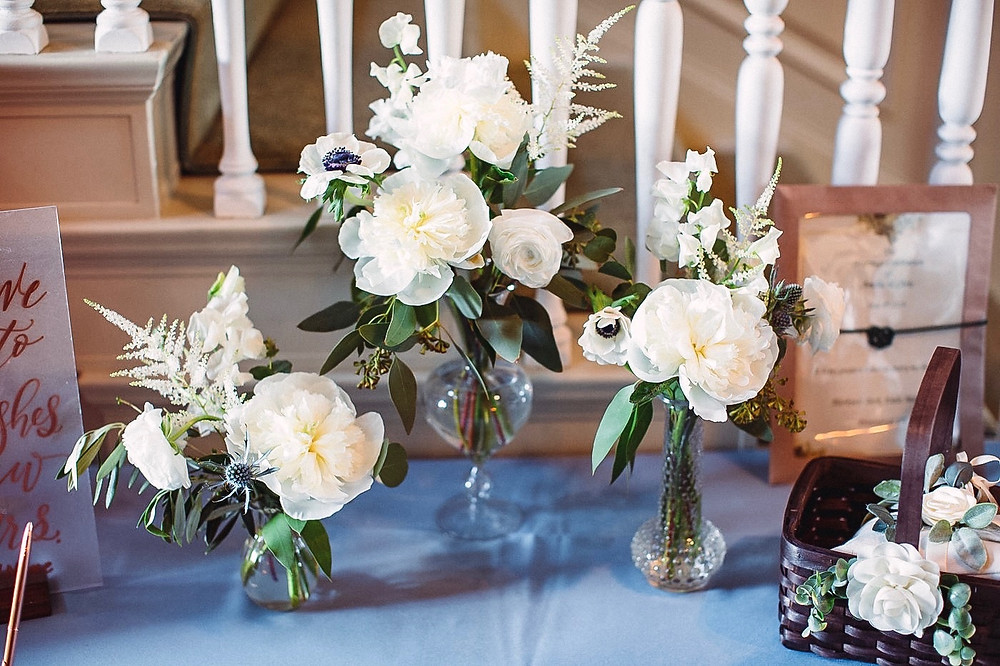 Welcome table flowers with white Peony, Astilbe, Sweetpea, Anemone, Ranunculus and Thistle.